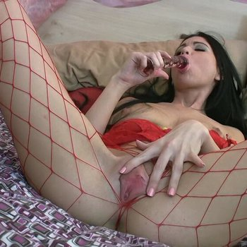 Chloe James toying her cunt through red fishnets