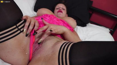 Big breasted British temptress playing with finger