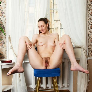 Young chick spreading legs to show that hairy bush