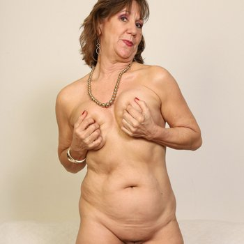 Hot mature Lynn teasing with her sexy body