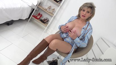 Lady Sonia opens dress and shows big tits