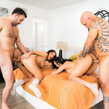 Two horny Latinas shares two cocks in hardcore