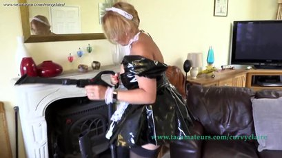 Curvy Claire does some vaccuuming in a kinky maid uniform