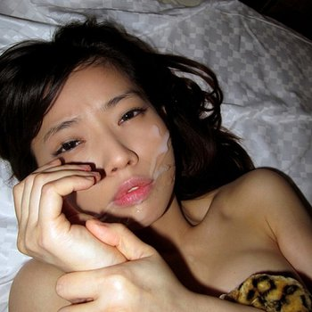 Sexy Asian teen gets her face sprayed with fresh jizz