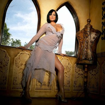Tory Lane shows off her curves in an exotic mansion