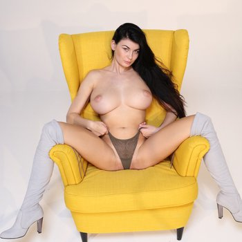 Amazing brunette girl Lucy stripping and showing her big tits
