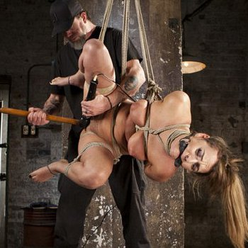 Charlotte Cross busty brunette is rope bound for toying and spanking