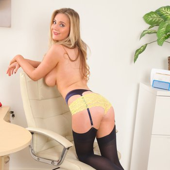 Busty Babe Beth Lily takes off her Skirt and Bra