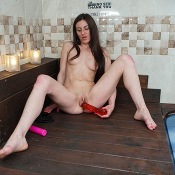 Real nympho puts a big red sex toy up her cunt
