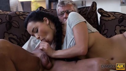Dark haired Erica Black jerks and sucks an old cock
