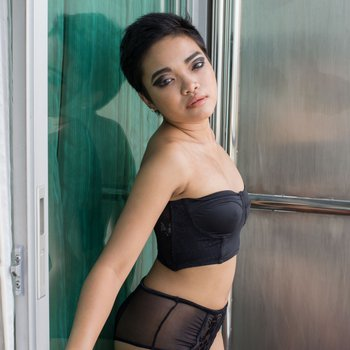 Short haired babe teasing with her body
