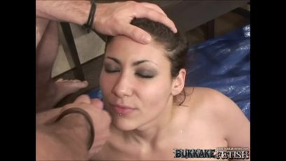 Busty Delicia enjoys a warm cum on her tits