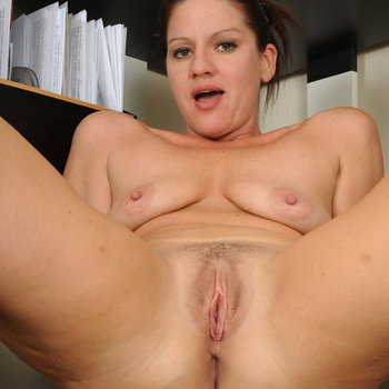 Sexy slim MILF Xena getting off in the office