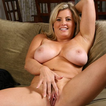 Kala Prettyman on a couch licking her own boobs