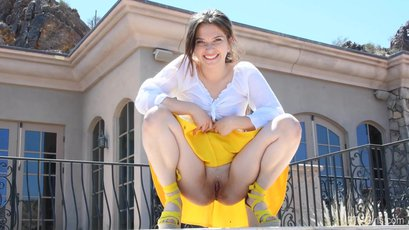 Naughty young brunette Olivia Sage gives us a hot summer upskirt