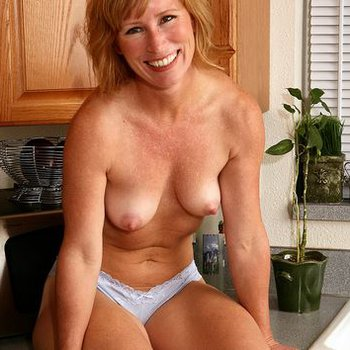 Naughty MILF Cheyanne stripping naked in kitchen