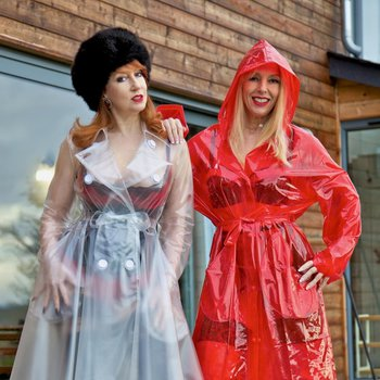 Red XXX and her bestie fucking in sexy raincoats and thigh-high boots
