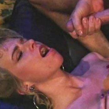 Kylie Ireland gets her face and tits jizzed over