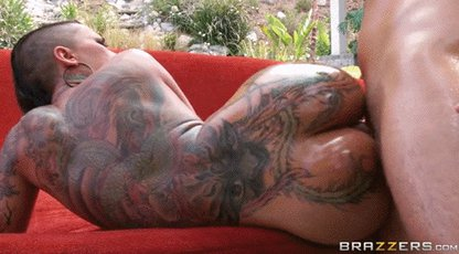 Tattooed babe is getting her pussy fucked hard