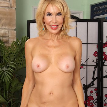 Sexy mature woman Erica Lauren strips and shows it all