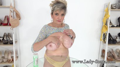 Jerk off on Lady Sonia's big mature oily boobs
