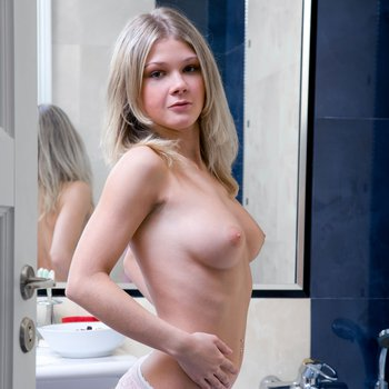Sexy young blond Valya loves to masturbate in bath