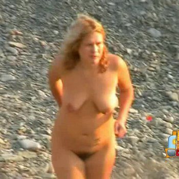 Amateur blonde girl showing off her hairy pussy on the beach