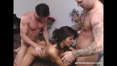 Brunette babe sucking and fucking two dudes