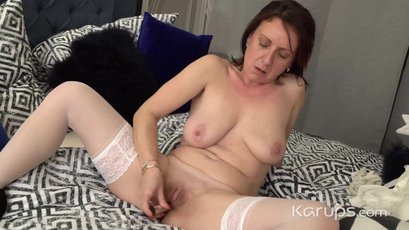 Linda G starts caressing her body and toys pussy