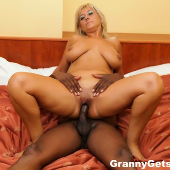 Blonde chick takes a black cock in her tight cunt