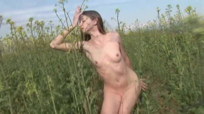 Dirty girl Mika A is enjoying herself in a field