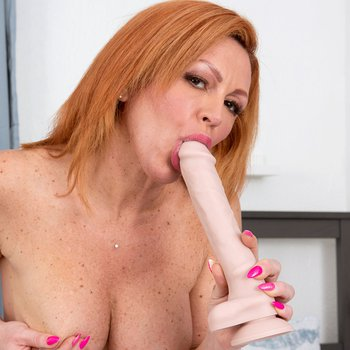 Horny Nina Lakes stuffs her pussy with big dildo