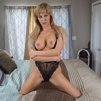 Busty blonde MILF Cherie Deville teasing with her tits