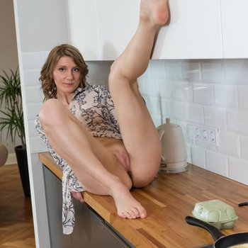 Playful hottie Maria Marnie teases in the kitchen