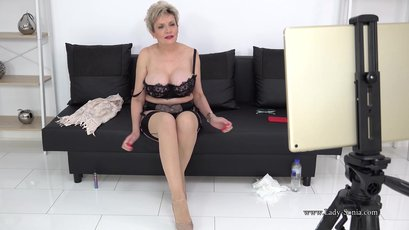 Busty mature Lady Sonia strips & fingers pussy