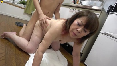 Japanese housewife gets fucked in the kitchen