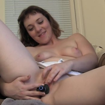 Busty babe in a chair ramming her pussy hard