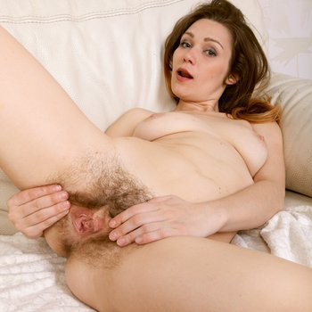 Amaya stripping and showing her hairy pussy