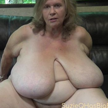 Solo girl Suzie Q showing off her fat body on the couch