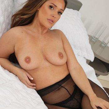 Frankie L with ample boobs and a superb tushy wearing pantyhose teasing