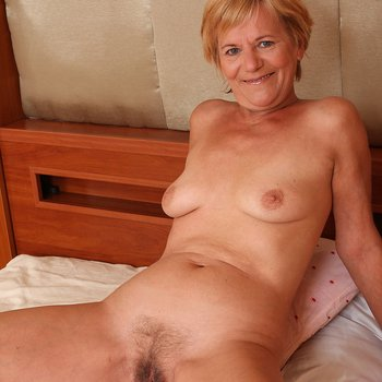 Playful mature Lili getting off in the bedroom