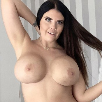 Busty Kylie K pops out her big naked boobs