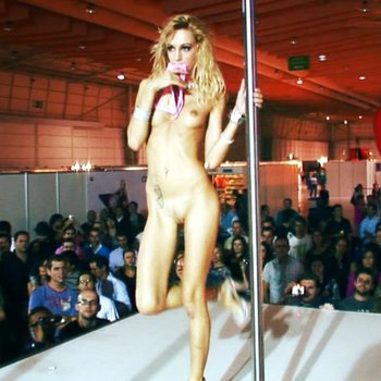 Saucy Erica Fontes strips and has fun with a pole