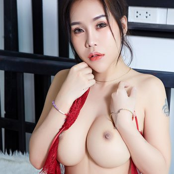 Thai chick with gorgeous round tits takes off red lace negligee