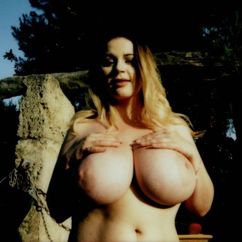 Holly Garner showing her big tits outdoors