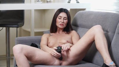 Horny MILF Eva Black playing with a large dildo