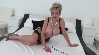 Busty granny Lady Sonia strips & helps jerking off