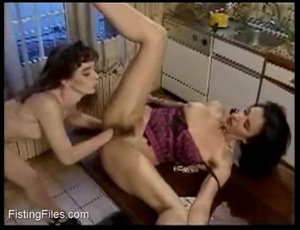 Hot brunette girl getting fisted by a friend