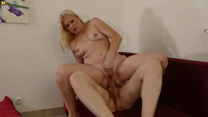 Blonde housewife fucking and sucking on a couch