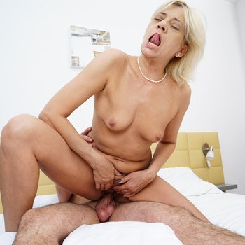 Hot blonde cougar bouncing on a hard cock